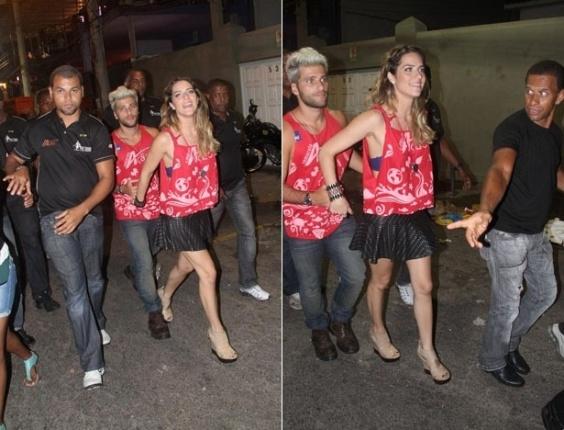 Bruno Gagliasso e a mulher, Giovanna Ewbank, saem escoltados de camarote do circuito Barra-Ondina (Dodô), em Salvador (16/02/12)